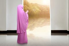 Back view of asian muslim woman praying. In the mosque at sunset Stock Images