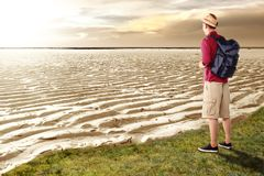 Back view of asian traveler standing on the dry ground royalty free stock image