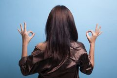 Back view of Asian woman show double OK hand sign. Royalty Free Stock Photography