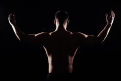 Back view of athletic man with bare torso Royalty Free Stock Images