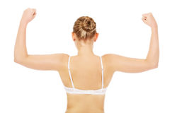 Back view of athletic woman show her muscles Royalty Free Stock Photo