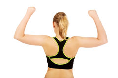 Back view of athletic woman showing muscles Stock Photography