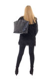 Back view of attractive trendy woman in warm clothes with handba Stock Photography