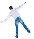 Back view of balancing  man in  shirt . Stock Photos