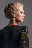 Back view of beautiful blonde woman looking away. Royalty Free Stock Photography