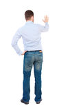 Back view of beautiful business man welcomes. Royalty Free Stock Photography