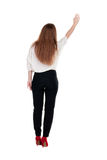 Back view of beautiful business woman welcomes. Royalty Free Stock Photo