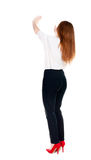 Back view of beautiful business woman welcomes. Stock Photos