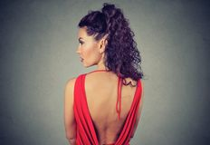 Back view of a beautiful elegant woman in red dress. Rear view of a beautiful elegant woman in red dress Stock Images