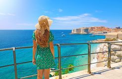 Back view beautiful girl looking at the old town of Dubrovnik in Croatia, Europe. Summer holidays on Mediterranean sea stock photos