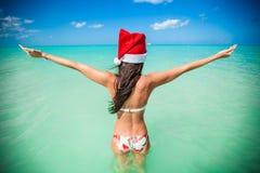 Back view of beautiful girl in santa hat walking Stock Photography