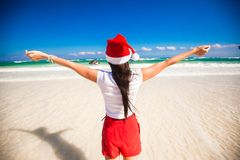 Back view of beautiful girl in Santa Hat walking Stock Images