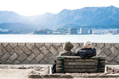 Back view of beautiful happy elderly japanese couple stock images