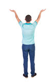 Back view of Beautiful man in jeans looking at wall and Holds  h Royalty Free Stock Image