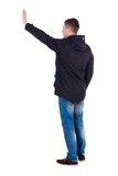 Back view of beautiful man welcomes. Royalty Free Stock Photography