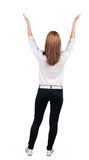 Back view of Beautiful woman in jeans looking at wall and Holds Stock Images