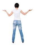 Back view of Beautiful woman in jeans looking at wall and Holds Stock Photos
