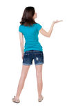 Back view of Beautiful woman in in sandals holds hand up. Royalty Free Stock Image
