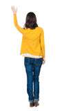 Back view of beautiful woman welcomes. Stock Photo