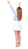 Back view of beautiful woman welcomes. Royalty Free Stock Photo