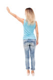 Back view of beautiful woman welcomes. Royalty Free Stock Image