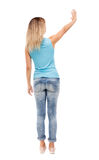 Back view of beautiful woman welcomes. Stock Image