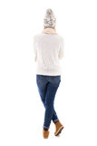 Back view of beautiful woman in winter clothes isolated on white Royalty Free Stock Image