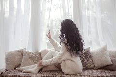 Back view of Beautiful young brunette woman wearing knitted swea Stock Images