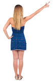Back of view beautiful young  woman in jeans dress pointing at w Royalty Free Stock Images