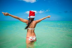 Back view of beautiful young woman in santa hat Royalty Free Stock Photos