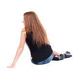 Back view beautiful young woman sitting on floor Royalty Free Stock Photography