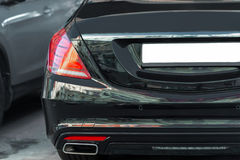 Back view of big luxury expensive sedan car trunk. Black colored Royalty Free Stock Photography