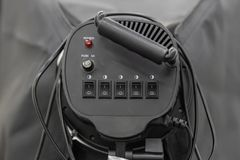 Back view of black spotlight or continuous light with on-off switch, wire and fuse. Back view of black spotlight or continuous light with on-off switch, fuse and royalty free stock images
