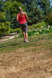Back view of blond woman practicing fitness in park Royalty Free Stock Photography