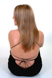 Back View Of Blonde Female. In black laced dress Stock Photo