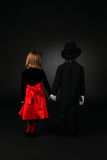 Back view of boy and girl in formal clothing Stock Images