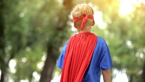 Back view of boy in superman costume, dreamy child, recreational activity royalty free stock photos