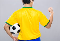 Back view of Brazil football player fist up Stock Image