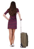 Back view of brunette woman with suitcase Stock Photo