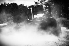 Back view of buggy riding along a country road. Stock Photography