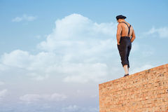 Back view of builder standing on brick. Stock Photography