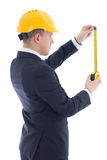 Back view of business man or architect in  builder's helmet with Royalty Free Stock Image