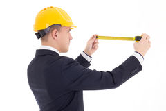 Back view of business man or architect in yellow builder's helme Stock Photography