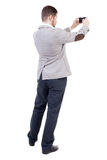 Back view of business man on phone photographs. Stock Image