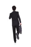 Back view of a business man running Stock Image