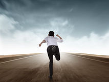 Back view of business man running. With motion blur effect Stock Photography