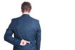 Back view of business man showing fingers crossed Stock Photos