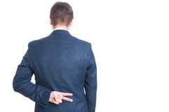 Back view of business man showing peace gesture Stock Image