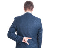 Back view of business man showing rock on gesture Stock Photography