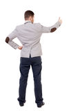 Back view of  business man shows thumbs up. Stock Image